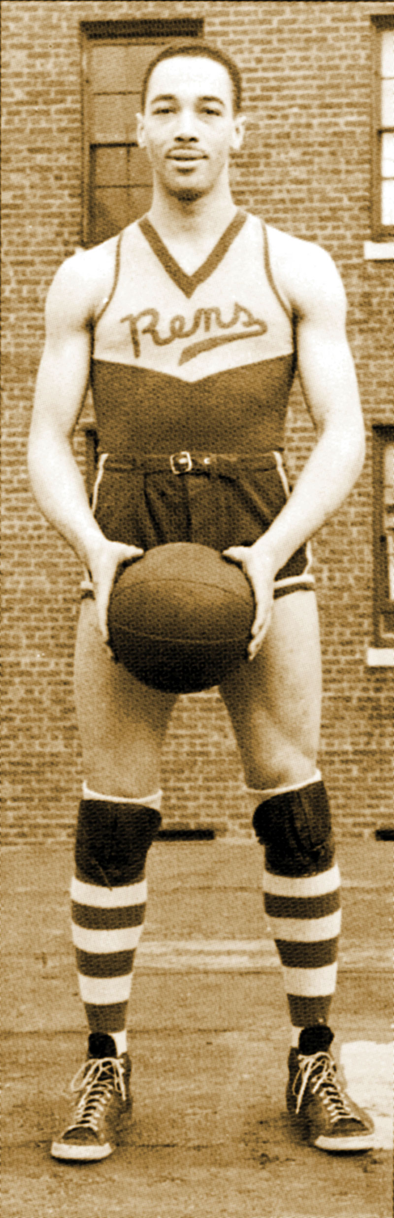 Photograph of New York Rens star John Isaacs in uniform, ca. 1939.